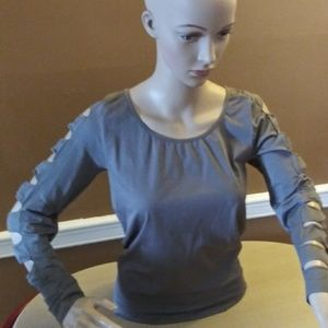 Venus.  sliced arm top, new never worn
